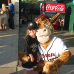 Hugging Boomer at Pump Jacks inaugural home opener on June 12, 2008