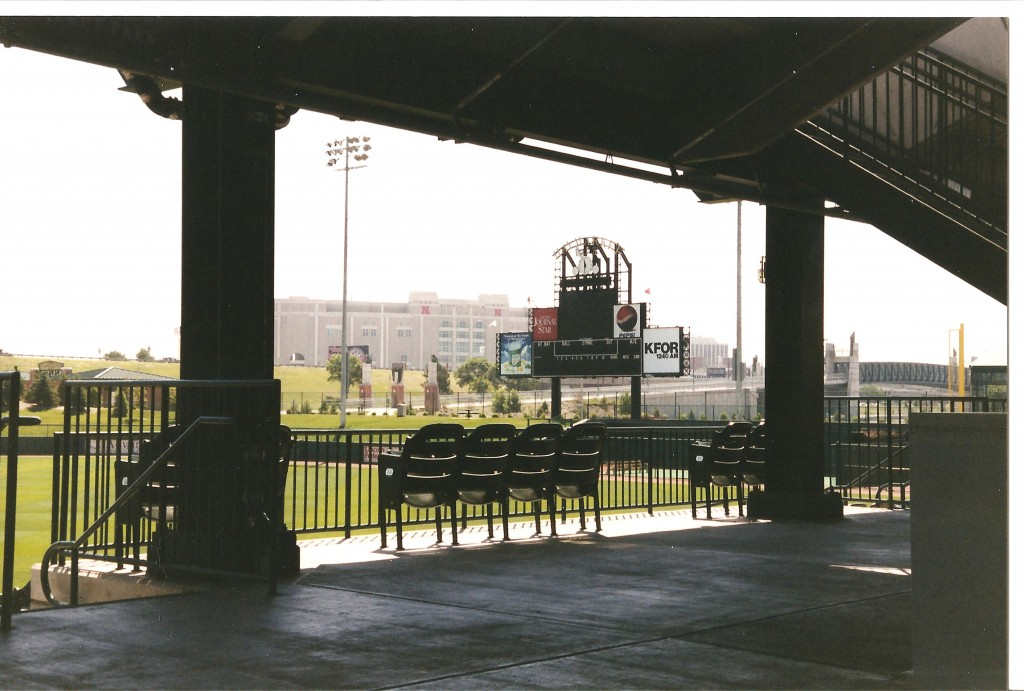 Memorial Stadium to the left of the scoreboard and pedstrian bridge to Lincoln to the right